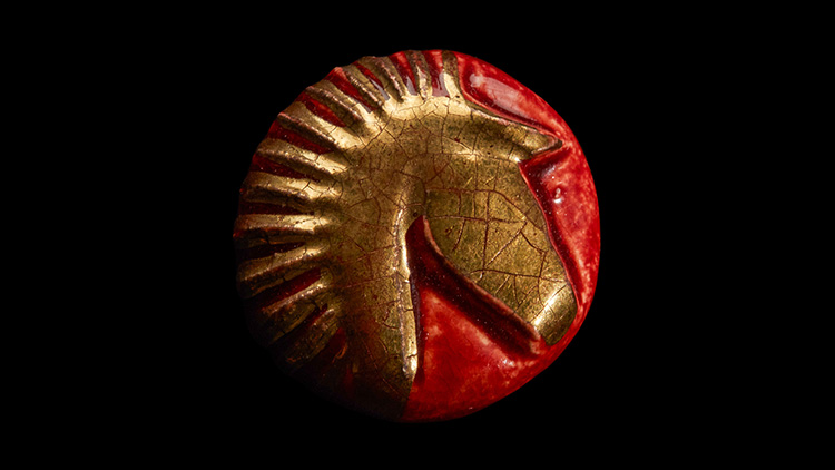 כפתור סוס זהב